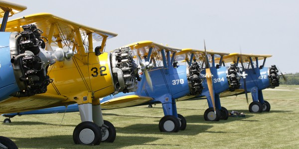 Stearman's starting up for formation flight.
